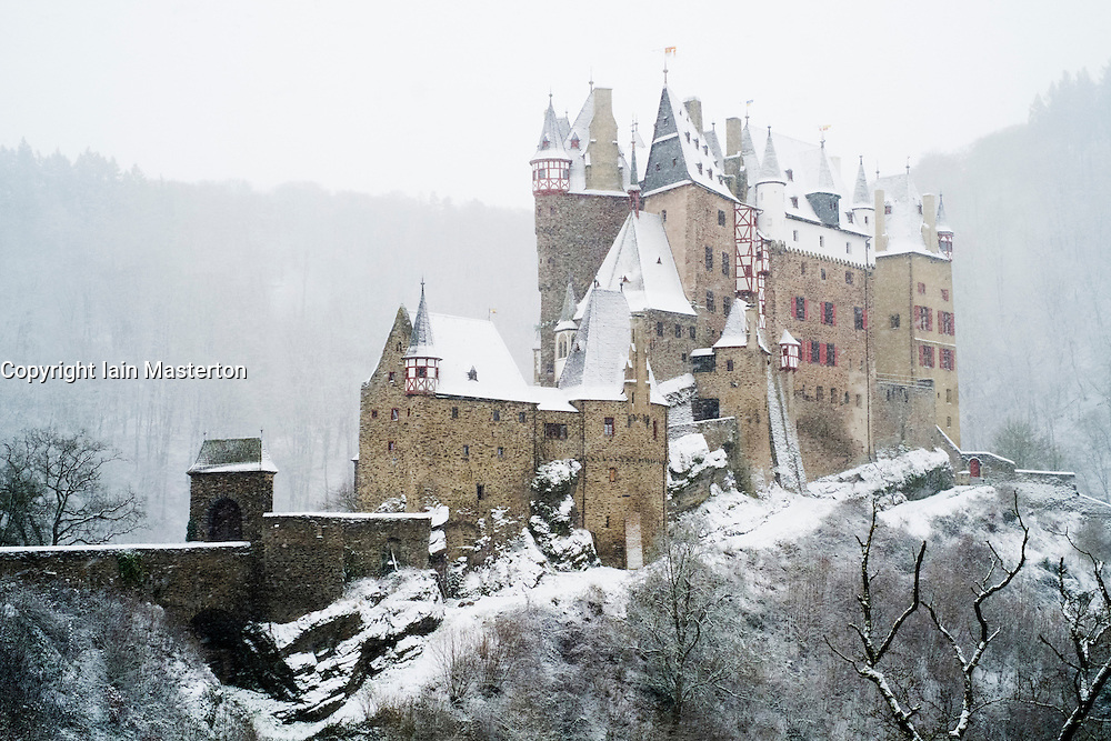 View of Burg Eltz castle in winter snow in Germany