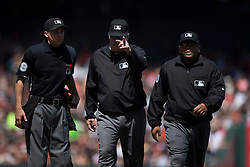 SAN FRANCISCO, CA - MAY 02:  MLB umpire Bill Miller #26 signals for a review while standing next to umpire Adam Hamari #78 and umpire Adrian Johnson #80 during the fifth inning between the San Francisco Giants and the Los Angeles Angels of Anaheim at AT&T Park on May 2, 2015 in San Francisco, California.  The San Francisco Giants defeated the Los Angeles Angels of Anaheim 5-4. (Photo by Jason O. Watson/Getty Images) *** Local Caption *** Bill Miller; Adam Hamari; Adrian Johnson