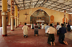 A few members of the local parish in Dutch Bar attend the first mass after the tsunami, Batticaloa, Sri Lanka, Jan. 16, 2005.