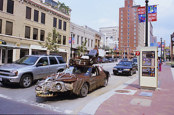 Stock photo of the piranha car driving in traffic in downtown