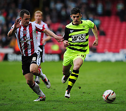 Sheffield United's Michael Doyle pulls on the shirt off Yeovil Town's Joe Edwards - Photo mandatory by-line: Dougie Allward/JMP - Tel: Mobile: 07966 386802 03/05/2013 - SPORT - FOOTBALL - Bramall Lane - Sheffield - Sheffield United V Yeovil Town - NPOWER LEAGUE ONE PLAY-OFF SEMI-FINAL FIRST LEG