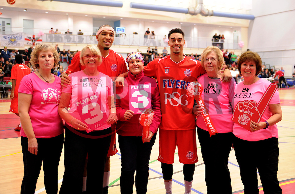 Greg Streete and Roy Owen of Bristol Flyers pose wth fund-raisers from BUST, the Bristol-based cancer charity - Photo mandatory by-line: Paul Knight/JMP - Mobile: 07966 386802 - 10/10/2015 - BASKETBALL - SGS Wise Arena - Bristol, England - Bristol Flyers v Newcastle Eagles - British Basketball League