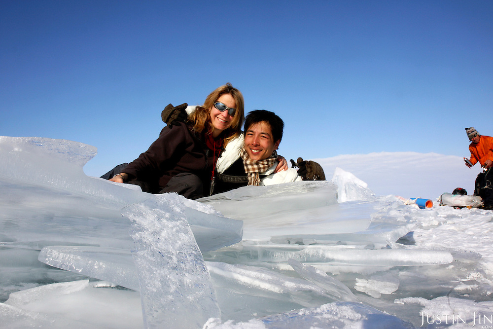 Heleen (Left) and Justin during their trek across frozen Lake Baikal in Siberia, Russia. .They are a group of five people: Justin Jin (Chinese-British), Heleen van Geest (Dutch), Nastya and Misha Martynov (Russian) and their Russian guide Arkady. .They pulled their sledges 80 km across the world's deepest lake, taking a break on Olkhon Island. They slept two nights on the ice in -15c. .Baikal, the world's largest lake by volume, contains one-fifth of the earth's fresh water and plunges to a depth of 1,637 metres..The lake is frozen from November to April, allowing people to cross by cars and lorries.