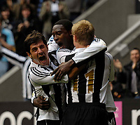 Photo: Jed Wee.<br /> Newcastle United v Bolton Wanderers. The Barclays Premiership. 15/10/2006.<br /> <br /> Newcastle's Emre (L) and Damien Duff (R) celebrate with goalscorer Shola Ameobi.