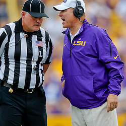 Oct 12, 2013; Baton Rouge, LA, USA; LSU Tigers head coach Les Miles talks with an official during the second half of a game against the Florida Gators at Tiger Stadium. LSU defeated Florida 17-6. Mandatory Credit: Derick E. Hingle-USA TODAY Sports