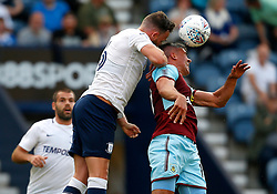 Preston North End's Andy Boyle wins a header above Burnley's Jonathan Walters - Mandatory by-line: Matt McNulty/JMP - 25/07/2017 - FOOTBALL - Deepdale Stadium - Preston, England - Preston North End v Burnley - Pre-Season friendly