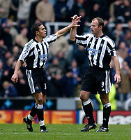 Photo. Jed Wee.<br /> Newcastle United v Liverpool, FA Barclaycard Premiership, St. James' Park, Newcastle. 06/12/03.<br /> Newcastle's Alan Shearer (R) and Laurent Robert congratulate each other after combining for Newcastle's equaliser.