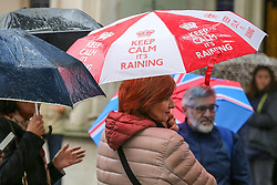 "© Licensed to London News Pictures. 10/06/2019. London, UK. A woman shelters from the rain beneath an umbrella, ""Keep Calm It's Raining"" written on it, as rain falls in the capital. The Met Office has issued an amber warning for more rain, covering London and parts of southeast England later today.  Photo credit: Dinendra Haria/LNP"