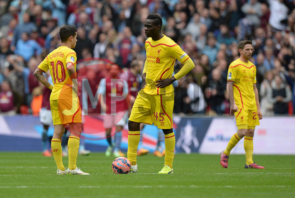 Liverpool's Mario Balotelli and Liverpool's Philippe Coutinho look dejected as they wait for the restart.  - Photo mandatory by-line: Alex James/JMP - Mobile: 07966 386802 - 19/04/2015 - SPORT - Football - London - Wembley Stadium - Aston Villa v Liverpool - FA Cup Semi-Final