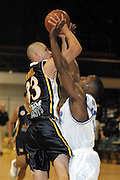 NBL Basketball 2002<br />Nelson Giants v Wellington Saints at Queens Wharf Event Centre in Wellington, 20/4/02<br />Judd Flavell takes a shot while Tony Brown puts up the defence.<br /><br />Pic: Sandra Teddy/Photosport<br />*digital image*