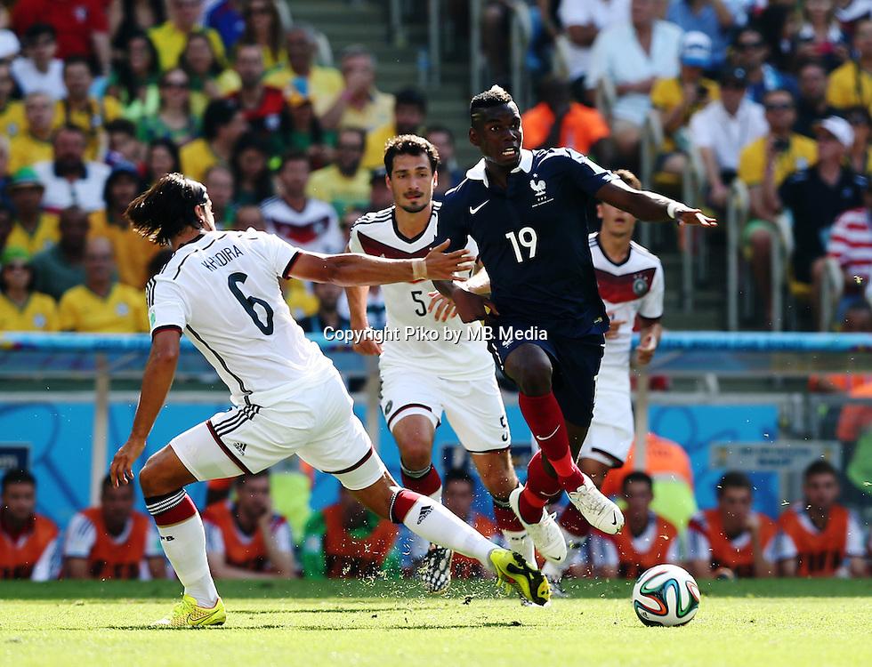Fifa Soccer World Cup - Brazil 2014 - <br /> FRANCE (FRA) Vs. GERMANY (GER) - Quarter-finals - Estadio do MaracanaRio De Janeiro -- Brazil (BRA) - 04 July 2014 <br /> Here German players Sami KHEDIRA (L), and Mats HUMMELS (C). French player Paul POGBA (C)<br /> &copy; PikoPress