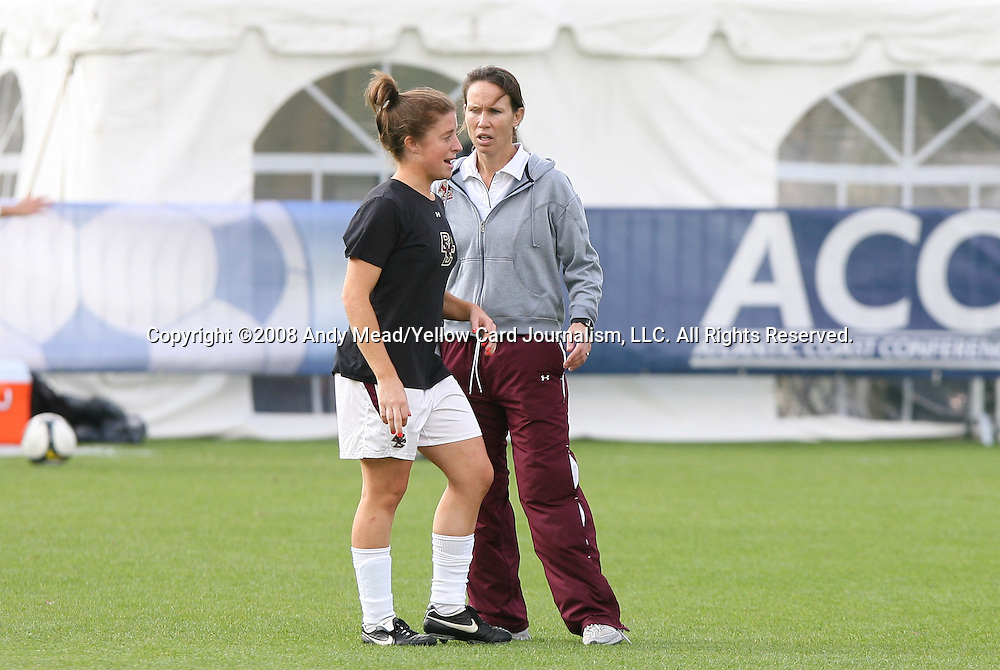 05 November 2008: Boston College head coach Alison Kulik (r) talks to a player. Boston College defeated Duke University 1-0 at Koka Booth Stadium at WakeMed Soccer Park in Cary, NC in a women's ACC tournament quarterfinal game.