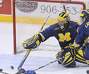 Michigan goaltender Bryan Hogan sweeps aside a shot during the Wolverines Friday win over the LSSU Lakers at Taffy Abel Arena in Sault Ste. Marie.