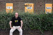 English author/writer Ian Sinclair in his native Hackney, the location for many of his dystopian views on East London. The condemned housing behind is in Dalston/Hackney whose former residents are also celebrated in a series of portraits before their demolition.