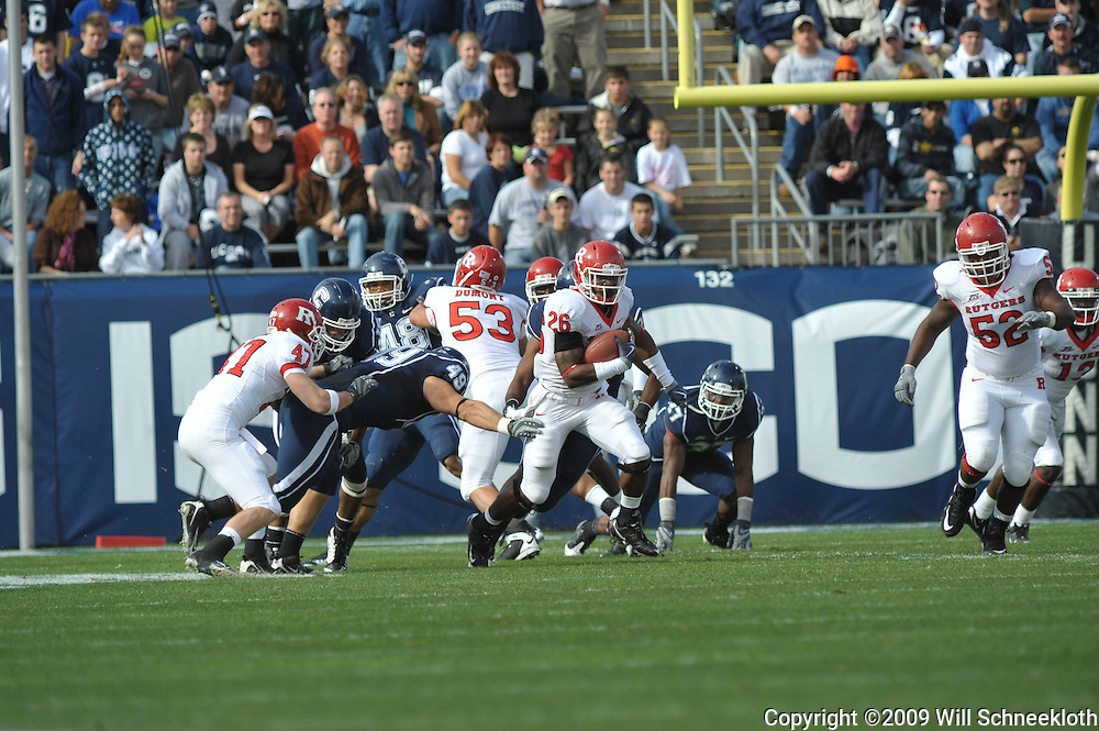 Oct 31, 2009; East Hartford, CT, USA; Rutgers cornerback Joe Lefeged (26) returns a kickoff during first half Big East NCAA football action between Rutgers and Connecticut at Rentschler Field.