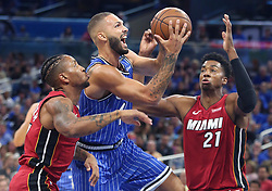 October 17, 2018 - Orlando, Florida, U.S. - The Orlando Magic's EVAN FOURNIER middle, drives between the Miami Heat's RODNEY MCGRUDER, left, and HASSAN WHITESIDE  (21) at the Amway Center. Orlando Magic beat Miami Heat 104:101. (Credit Image: © Stephen M. Dowell/Orlando Sentinel/TNS via ZUMA Wire)