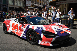 © Licensed to London News Pictures. 05/08/2018. LONDON, UK. A McLaren sets off from the start.  Gumball 3000, a charity rally for supercars and more, including celebrity entrants, begins in Covent Garden with 150 participants beginning their journey from London to Tokyo.  Photo credit: Stephen Chung/LNP