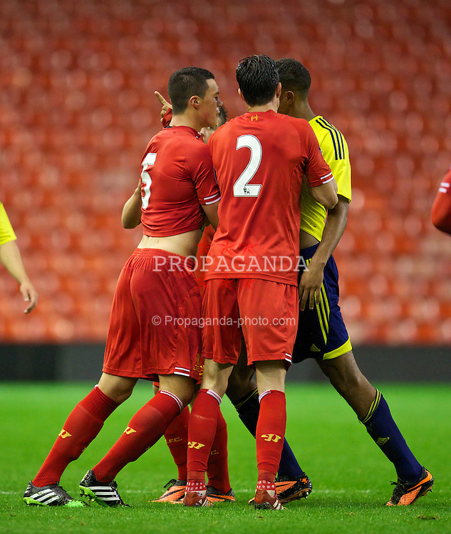 LIVERPOOL, ENGLAND - Tuesday, September 17, 2013: Liverpool's Lloyd Jones clashes with a Sunderland player during the Under 21 FA Premier League match at Anfield. (Pic by David Rawcliffe/Propaganda)