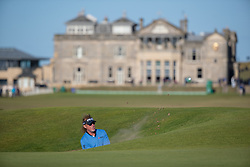 Miguel Angel Jimenez plays from the road hole bunker at the 17th hole during day three of the Senior Open at Old Course St Andrews.