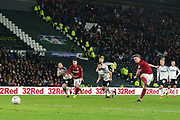 Northampton Town striker Sam Hoskins scores from the penalty spot during the The FA Cup match between Derby County and Northampton Town at the Pride Park, Derby, England on 4 February 2020.