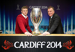 +++ FREE USE FOR STORIES PROMOTING THE UEFA SUPER CUP 2014 ONLY +++<br /> <br /> CARDIFF, WALES - Monday, February 17, 2014: Former Wales captain Kevin Ratcliffe [R] and Cardiff City manager manager Ole Gunnar Solskj&aelig;r [L] launch the UEFA Super Cup 2014 which will be played at the Cardiff City Stadium on 12th August. (Pic by David Rawcliffe/Propaganda)