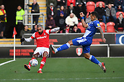 Bristol Rovers forward Jonson Clarke-Harris (9)  and Rotherham United player Kyle Vassell (7) during the EFL Sky Bet League 1 match between Rotherham United and Bristol Rovers at the AESSEAL New York Stadium, Rotherham, England on 18 January 2020.