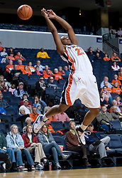 Virginia guard Monica Wright (22) leaps for a pass that went over her head.  The Virginia Cavaliers women's basketball team defeated the Davidson Wildcats 83-68 at the John Paul Jones Arena in Charlottesville, VA on December 20, 2007.