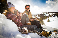 Sun Valley Idaho Winter and Fall Shoot for Woolrich of couple in a winter camp enjoying taking pictures with the mountains in the background