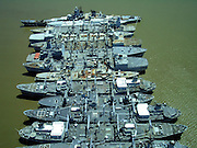 The Gost Ships of the National Defense Reserve Fleet<br /> <br /> After the second World War, the United States established the National Defense Reserve Fleet (NDRF) – a fleet of vessels that serve as a reserve of ships for national defense and national emergency purposes. The fleet consist of mostly merchant vessels, that can be activated within 20 to 120 days to provide shipping during national emergencies, either military or non-military, such as commercial shipping crises. At its height in 1950, the NDRF consisted of 2,277 ships at eight anchorage sites: James River, Virginia; Beaumont, Texas; Suisun Bay, California; Stony Point, New York; Wilmington, North Carolina; Mobile, Alabama; Astoria, Oregon; and Olympia, Washington.<br /> <br /> Only the first three, out of the original eight, exist today. Long years of neglect and disuse have turned these ships into near wrecks, with flaking paint polluting the waters with heavy metals and hazardous chemicals. As of April 30, 2014, only 122 vessels are left in the NDRF, and their numbers are reducing still.<br /> <br /> Since its establishment, NDRF vessels were used in seven wars and crises situations. During the Korean War, 540 vessels were broken out to move military forces. During a worldwide tonnage shortfall in 1951–53, more than 600 ships were reactivated to carry coal to Northern Europe and grain to India. From 1955 through 1964, another 600 ships were used to store grain for the Department of Agriculture. Another 223 cargo ships and 29 tankers were activated during a tonnage shortfall after the Suez Canal was closed in 1956. During the Berlin crisis of 1961, 18 vessels were activated and remained in service until 1970. Another 172 vessels were activated for the Vietnam War.<br /> <br /> In 1976, the NRF was augmented by the Ready Reserve Fleet (RFF) to provide for military emergencies. In August of 1990, 78 ships were deployed to support Operations Desert Storm during the Gulf War. Between August 1990 and April 1991, the ships transported 750,000 short