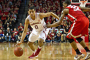 January 20, 2014: Tai Webster (0) of the Nebraska Cornhuskers drives around Lenzelle Smith Jr. (32) of the Ohio State Buckeyes at the Pinnacle Bank Arena, Lincoln, NE. Nebraska won in the game against Ohio State 68 to 62.