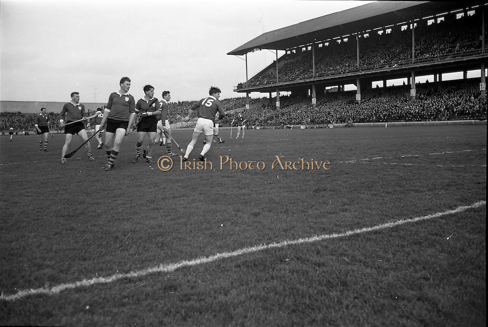 17/03/1967<br /> 03/17/1967<br /> 17 March 1967<br /> Railway Cup Final: Munster v Leinster at Croke Park, Dublin. <br /> T. Neville (Leinster) clears the ball while D. Nealon (Munster) and E. Colfer (Leinster) try to get possession during a Munster attack.