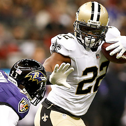 Aug 28, 2014; New Orleans, LA, USA; New Orleans Saints running back Mark Ingram (22) stiff arms Baltimore Ravens defensive back Chykie Brown (23) during the first quarter of a preseason game at Mercedes-Benz Superdome. Mandatory Credit: Derick E. Hingle-USA TODAY Sports