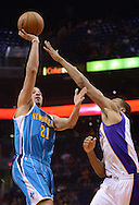 Apr 7, 2013; Phoenix, AZ, USA; New Orleans Hornets guard Greivis Vasquez (21) lays up the ball against the Phoenix Suns forward Wesley Johnson (2) in the second half at US Airways Center. The Hornets defeated the Suns 95-92. Mandatory Credit: Jennifer Stewart-USA TODAY Sports
