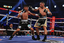 June 15, 2013; Dallas, Texas; USA;  Mikey Garcia and Juan Manuel Lopez during their HBO Boxing After Dark bout at the American Airlines Center.  Photo: Ed Mulholland/HBO  **HBO USAGE ONLY**