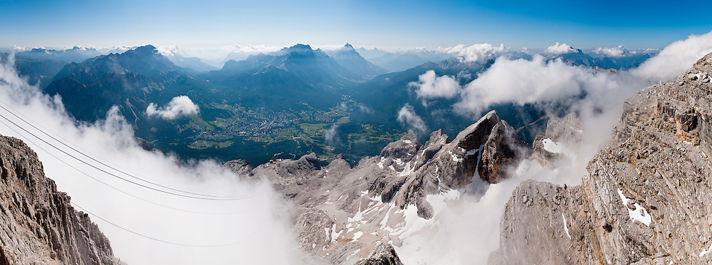 """From the ski resort of Cortina d'Ampezzo, ride a cable car lift to Tofana di Mezzo (3244 meters / 10,643 feet, third highest peak in the Dolomites) in Tofane mountain group, in the Dolomiti (a part of the Southern Limestone Alps), in the Veneto region, Italy, Europe. This ski resort hosted the 1956 Winter Olympics and motion pictures including: """"The Pink Panther"""" (1963), """"For Your Eyes Only"""" (1981, James Bond stunt sequences); and """"Cliffhanger"""" (1993). Here at the head of Valle del Boite, nearby peaks include Pomagagnon to the north, Cristallo to the northeast, Faloria and Sorapiss to the east, and Becco di Mezzodì, Croda da Lago and Cinque Torri to south. The Dolomites were declared a natural World Heritage Site (2009) by UNESCO. Panorama stitched from 10 overlapping photos."""