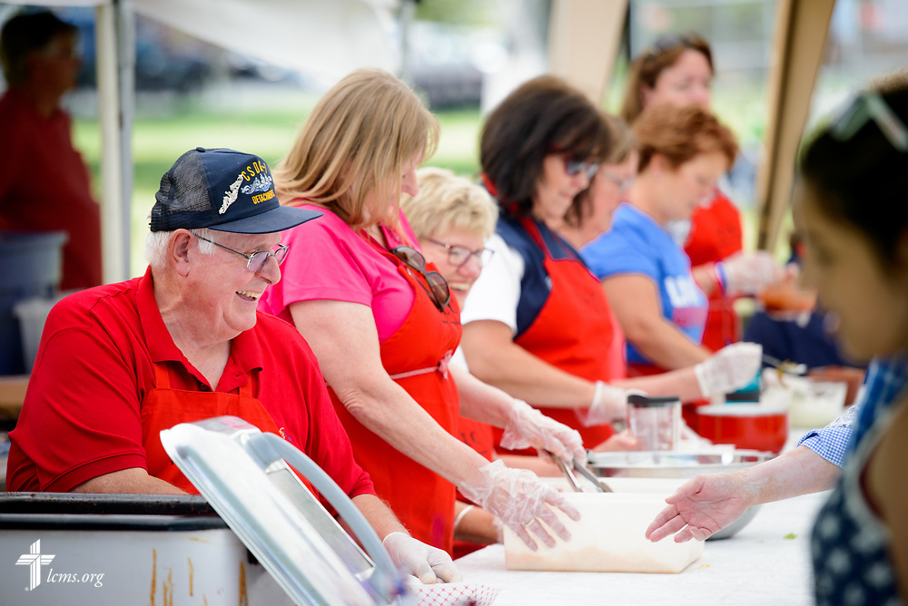 Charlie Sims, a lifelong Lutheran and member at Trinity Lutheran Church, Grangeville, Idaho, welcomes guests to the church's walking tacos tent at the Grangeville Border Days Independence Day celebration and parade on Tuesday, July 4, 2017, in Grangeville. LCMS Communications/Erik M. Lunsford