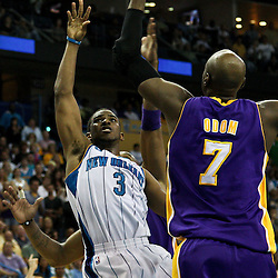 April 24, 2011; New Orleans, LA, USA; New Orleans Hornets point guard Chris Paul (3) shoots over Los Angeles Lakers power forward Lamar Odom (7) during the fourth quarter in game four of the first round of the 2011 NBA playoffs at the New Orleans Arena. The Hornets defeated the Lakers 93-88.   Mandatory Credit: Derick E. Hingle