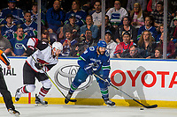KELOWNA, BC - SEPTEMBER 29:  Kevin Connauton #44 of the Arizona Coyotes checks Darren Archibald #49 of the Vancouver Canucks as he looks for the pass at Prospera Place on September 29, 2018 in Kelowna, Canada. (Photo by Marissa Baecker/NHLI via Getty Images)  *** Local Caption *** Darren Archibald;Kevin Connauton