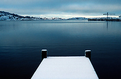 SWEDEN FJALLBACKA JAN04 - A snow-covered pier in Fjallbacka bay.. . . jre/Photo by Jiri Rezac. . © Jiri Rezac 2004. . Contact: +44 (0) 7050 110 417. Mobile:  +44 (0) 7801 337 683. Office:  +44 (0) 20 8968 9635. . Email:   jiri@jirirezac.com. Web:    www.jirirezac.com.