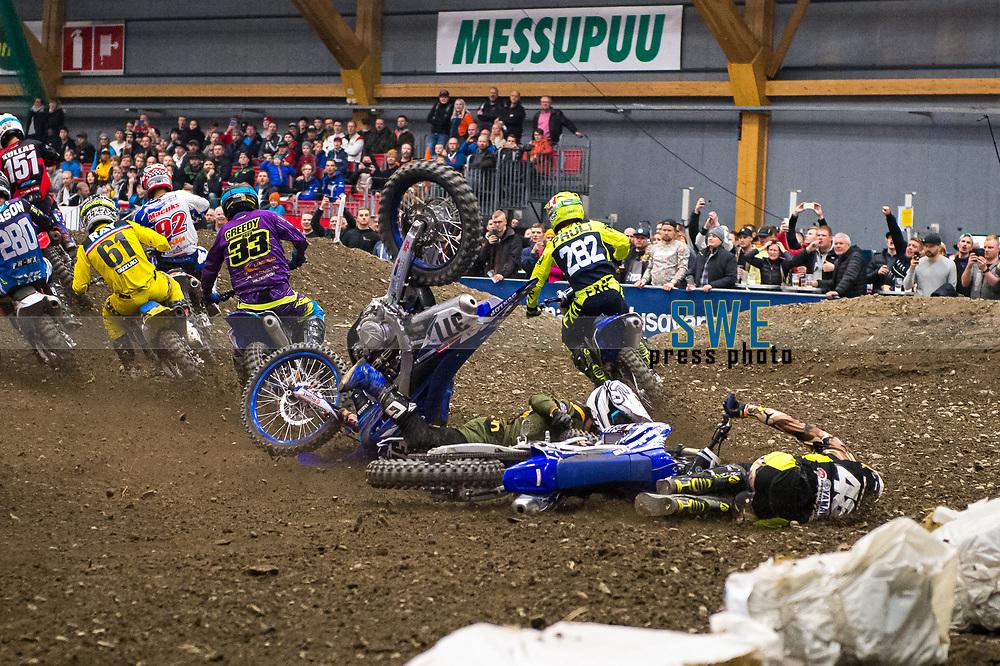 2019-11-08 | Messu- ja urheilukeskus, Tampere: (377) Nichlas Bjerregaard and (48) Joan Cros crash after the start during Tampere Supercross in Messu- ja urheilukeskus. ( Photo by: Elmeri Elo | Swe Press Photo )