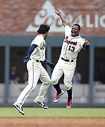 ATLANTA, GA - MAY 20:  Shortstop Dansby Swanson #7 of the Atlanta Braves celebrates with left fielder Ronald Acuna, Jr. #13 after Swanson hit a 2-run, game-winning walkoff single in the ninth  inning during the game against the Miami Marlins at SunTrust Park on May 20, 2018 in Atlanta, Georgia.  (Photo by Mike Zarrilli/Getty Images)