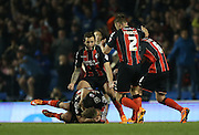 AFC Bournemouth striker Yann Kermorgant opens the scoring during the Sky Bet Championship match between Brighton and Hove Albion and Bournemouth at the American Express Community Stadium, Brighton and Hove, England on 10 April 2015.