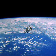 NASA Astronaut Robert L. Stewart Floats Above Cloudy Earth During an Untethered Extravehicular Activity (EVA) , February 1984