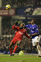 Photo: Dave Howarth.<br /> Everton v Liverpool. The Barclays Premiership. 28/12/2005. Liverpool's Djibril Cisse goes for an overhead shot on goal past Everton's Joseph Yobo