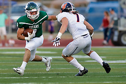 {BLOOMINGTON, IL: Corey Kennedy defends the run by Bryce Dooley during a college football game between the IWU Titans  and the Wheaton Thunder on September 15 2018 at Wilder Field in Tucci Stadium in Bloomington, IL. (Photo by Alan Look)