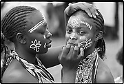 She who spends time adorning herself knows she is going to dance.  Kenyan proverb<br />