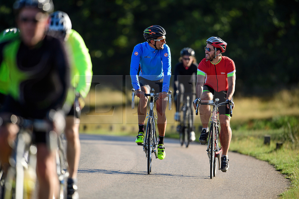 © Licensed to London News Pictures. 09/10/2016. London, UK. Cyclists make their way through Richmond Park on a bright autumnal morning. Photo credit: Ben Cawthra/LNP