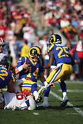 Los Angeles Rams quarterback Sean Mannion (14) and San Francisco 49ers defensive tackle Sheldon Day (96) in action during the 2017 NFL week 17 regular season football game against the San Francisco 49ers, Sunday, Dec. 31, 2017 in Los Angeles. The 49ers won the game 34-13. (©Paul Anthony Spinelli)
