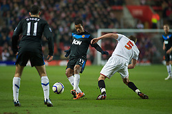 SOUTHAMPTON, ENGLAND - Saturday, January 29, 2011: Manchester United's Nani and Southampton's Ryan Dickson challenge for the ball during the FA Cup 4th Round match at St. Mary's Stadium. (Photo by Gareth Davies/Propaganda)