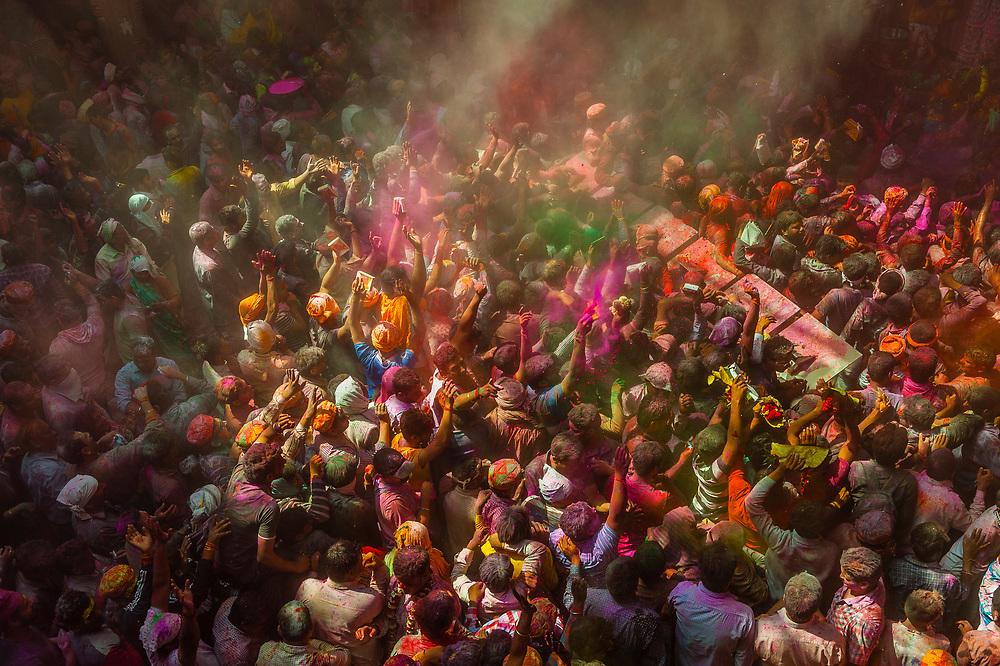 Holi Festival celebration (Festival of Colors) inside the Banke Bihari Temple, Vrindavan, near Mathura, Uttar Pradesh, India.